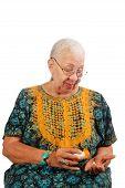 Elderly Woman Taking Pills