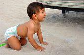 Cute Baby Boy On The Sand