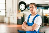 Car mechanic in workshop