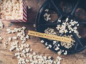 Film Reel With Popcorn And Tickets poster
