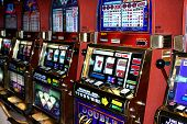 stock photo of slot-machine  - shooting down a row of slot machines - JPG