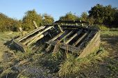 stock photo of collier  - Remains of the Severn Collier built in Stourport 1937 and beached at Purton in 1965 to help prevent the River Severn erroding into the Gloucester Sharpness Canal - JPG