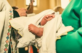 stock photo of christening  - The ceremony of christening the little boy at church  - JPG