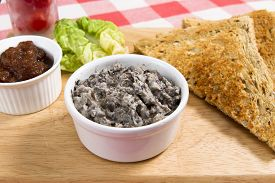 foto of canard  - Mushroom pate on a wooden board with pickle - JPG