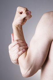 stock photo of cubit  - Man with pain in arm - JPG