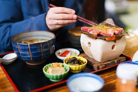 pic of japanese magnolia  - Traditional Japanese lunch with hida beef prepared on grill - JPG