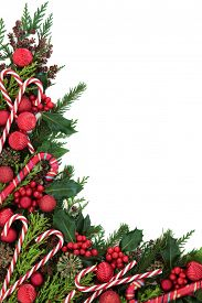 foto of candy cane border  - Christmas abstract background border with candy cane decorations - JPG