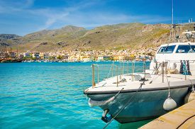 picture of piraeus  - Small speed boat moored on clear water of Aegan sea on Greek coast - JPG