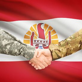 foto of french polynesia  - Soldiers shaking hands with flag on background  - JPG