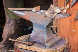 stock photo of anvil  - Detail shot of hammer on blacksmith anvil - JPG
