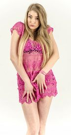picture of tunic  - A girl in a light pink transparent tunic dress fun - JPG