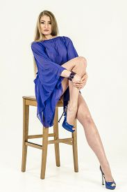 picture of tunic  - A girl in a light blue cape transparent tunic and high heels - JPG