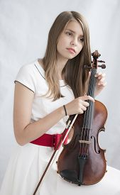 stock photo of viola  - Portrait of young beautiful  teenage girl with viola - JPG