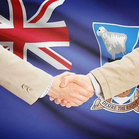 stock photo of falklands  - Businessmen shaking hands with flag on background  - JPG