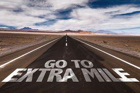 stock photo of mile  - Go To Extra Mile written on desert road - JPG