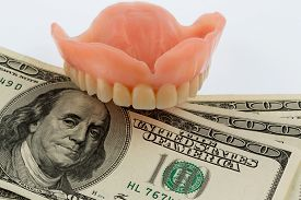 pic of two dollar bill  - dentures and dollar bills symbol photo for dentures - JPG