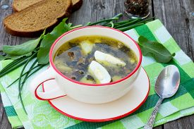 picture of sorrel  - Sorrel soup with egg and greens on a wooden background - JPG