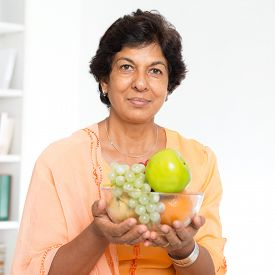 stock photo of indian apple  - Old people healthy eating - JPG