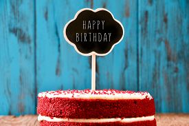 foto of red velvet cake  - a red velvet cake with a chalkboard in the shape of a thought bubble with the text happy birthday - JPG