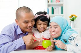 pic of malay  - Malay family pointing to an apple - JPG