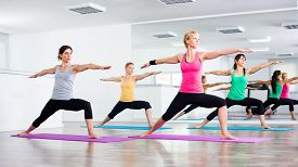 picture of virabhadrasana  - Four girls practicing yoga - JPG