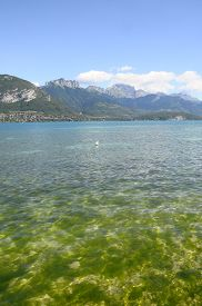 stock photo of annecy  - Overview of Lake of Annecy and Forclaz mountain in france  - JPG