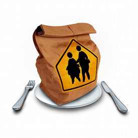 pic of obese children  - School obesity problem and children lunch diet social issue as a nutrition crisis concept as a brown paper lunch bag with two overweight fat kids on a a crossing traffic sign as a nutrition risk symbol for the youth - JPG