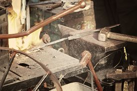 stock photo of anvil  - Blacksmith workshop with anvil and fire - JPG