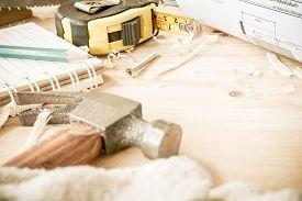 pic of chisel  - carpenter toolshammermeternailsshavings and chisel over wood table - JPG