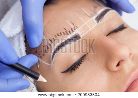 poster of Permanent Make-up For Eyebrows Of Beautiful Woman With Thick Brows In Beauty Salon. Closeup Beautici