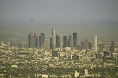 picture of land-mass  - Los Angeles cityscape layered in smog on an otherwise clear day - JPG