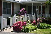 image of handicap  - a beautiful white picket handicap ramp is shown surrounded by a gorgeous flower garden in bloom  - JPG