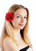 Pretty girl with flower in her hair