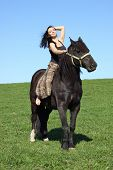 stock photo of beautiful horses  - Portrait of an attractive girl and her black horse - JPG
