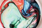 Abstract Colorful Backgrounds and Textures. Various colors of the Rainbow swirl and twist in a Psych poster