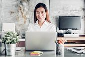 Asian Businesswoman Working With Laptop Computer On Desk With Smiling Face,happy Office Life Concept poster