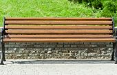 wooden bench in a city park
