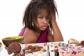 stock photo of bulimic  - Pretty black woman looking nauseous after having eaten too much - JPG