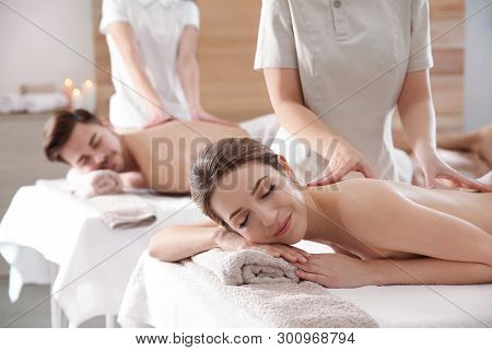 poster of Romantic Young Couple Enjoying Back Massage In Spa Salon