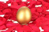Golden egg on a bed of rose petals