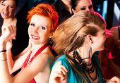 Women in club or disco dancing