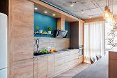 Modern Furniture In Luxury Kitchen. Minimalist Scandinavian Interior In Loft Apartment With Wooden F poster