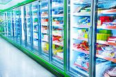 picture of frozen food  - Interior of empty supermarket aisle and lights