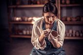 Stylish Female Master Enjoying Pottery Art And Production Process. Making Pottery. poster