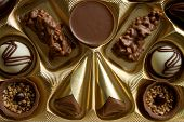 Variety Of Chocolate Candies. Luxurious Box Of Chocolates.decorated Chocolate Candies, Bitter And Wh poster