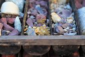 Stacking of old ore samples laying at the disposal area - exploration and mining industry poster