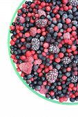 Frozen mixed fruit in bowl - berries - red currant cranberry raspberry blackberry bilberry blueberry
