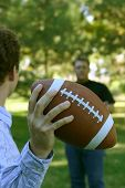 Two Men Throwing The Football