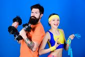 Be Strong. Strong Muscles And Body. Sporty Couple Training With Barbell And Skipping Rope. Athletic  poster