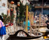 Incense Sticks On Joss Stick Pot Burning And Smoke Used To Pay Respect To Buddha. poster
